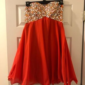 Orange strapless sequined dress